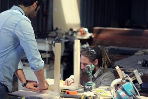 Jesse and Abde working on a prototype of Abde's chair design